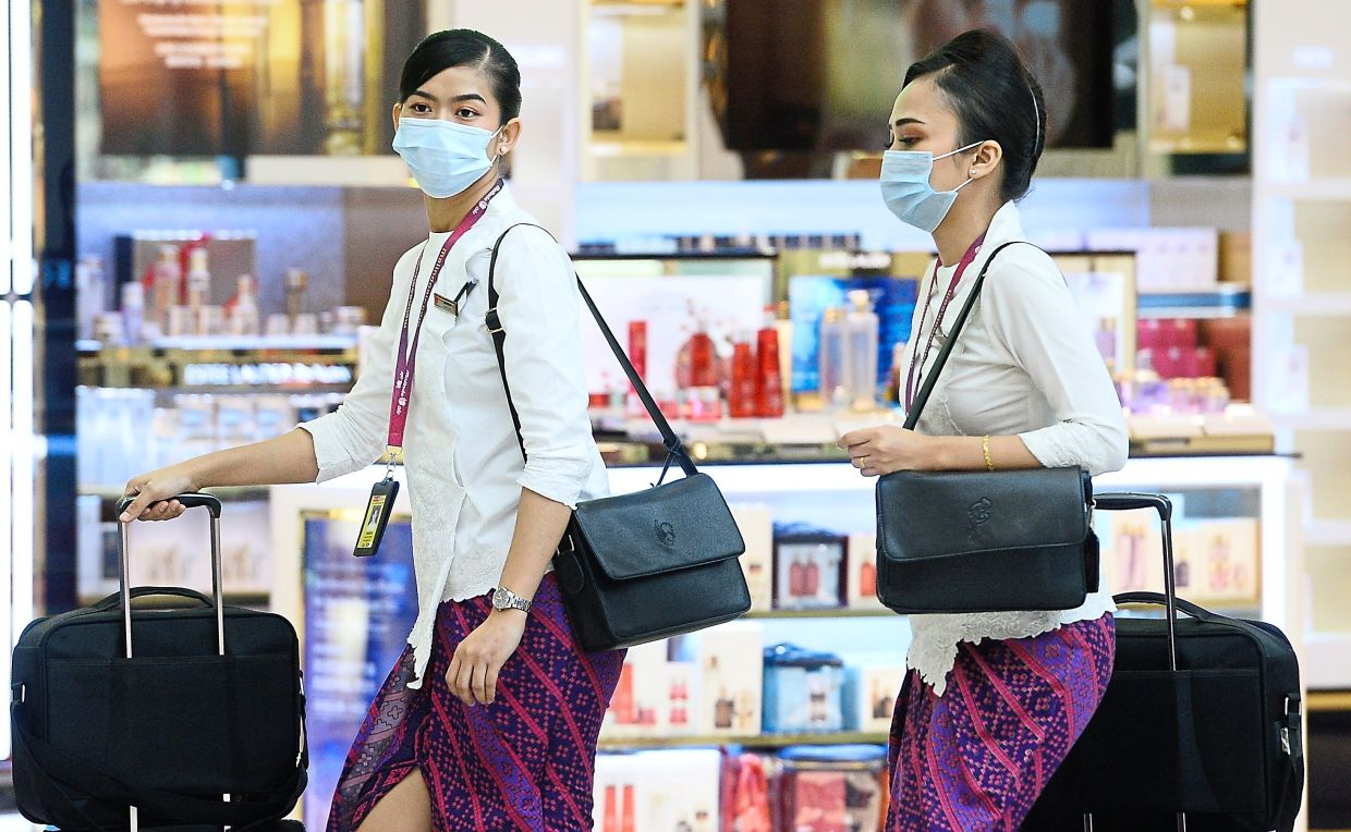 Stewardess wearing face mask amid fears over spread of the Covid-19 coronavirus at KLIA