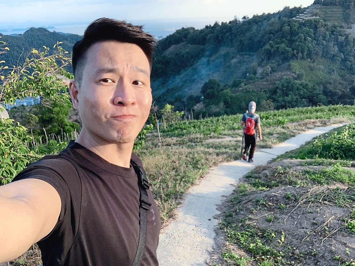 Awyong was in Penang before the coronavirus crisis escalated in the country. Here he's seen hiking a trail at Paya Terubong. — MORGAN AWYONG