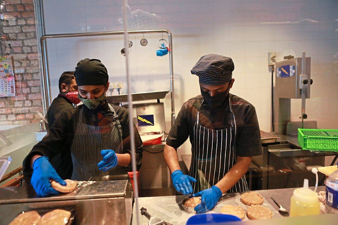 Navin's brand The Food Company, which produces and delivers burger patties, marinated meats, sausages and other meals has done well during the MCO, but not enough to sustain the losses from his restaurants. — The Food Company