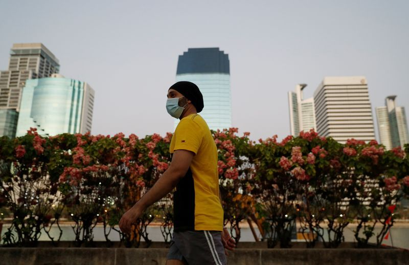 A man wearing a protective face mask walks during the spread of coronavirus disease COVID-19 in Bangkok Thailand March 29 2020. REUTERSJorge Silva