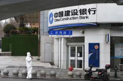 China's big banks flag asset pressure due to virus