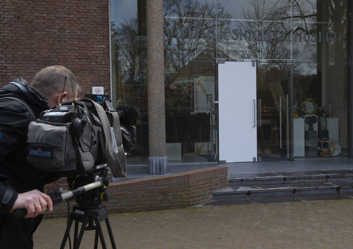 A cameraman films the glass door which was smashed during a break-in at the Singer Museum. Police are investigating a break-in at the Dutch art museum that is currently closed because of restrictions aimed at slowing the spread of Covid-19. Photo: AP