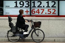 Asia shares inch up, China's factories show flicker of life