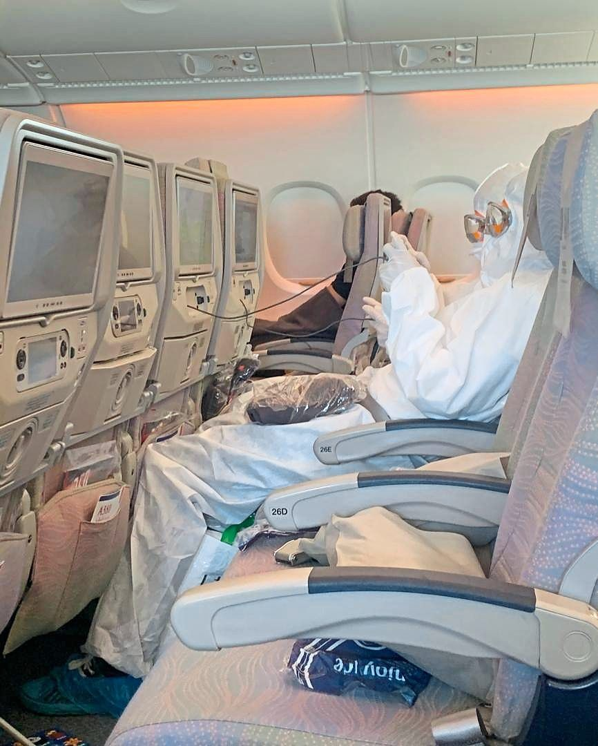 Laxmi felt safe during her flight to Kuala Lumpur as passengers flanking her wore full hazmat suits in the plane.