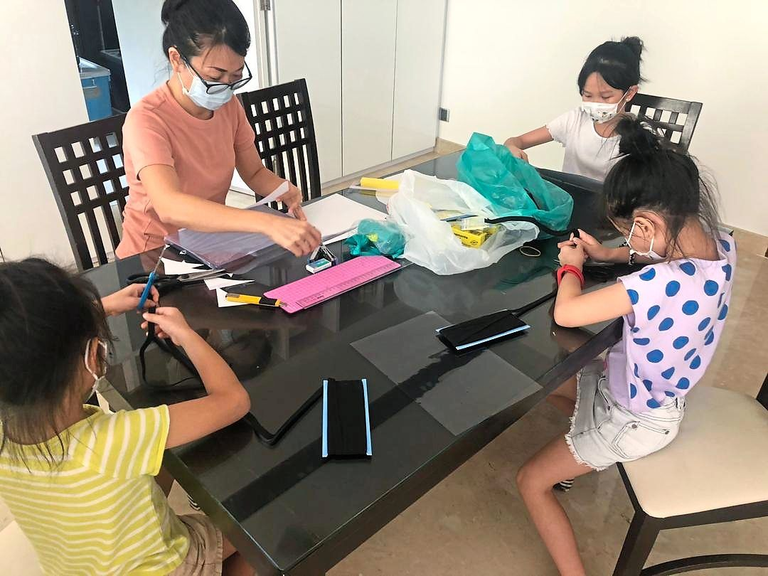This mother and her daughters are among an estimated 120 people from the TTDI community involved in making the face shields.