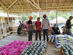 Jakoa distributes foodstuff to Orang Asli in Gerik