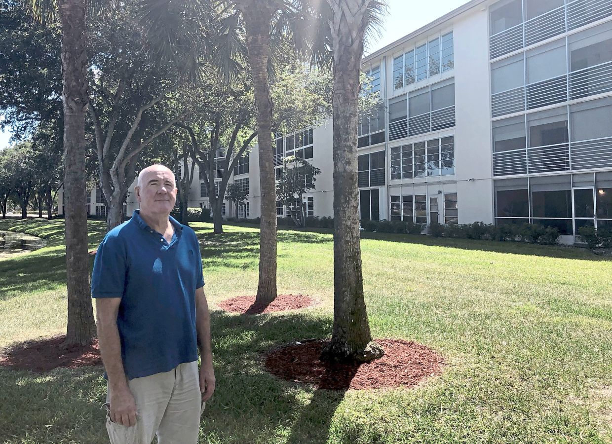 O'Brien outside the Lucaya Village complex in the Wynmoor community of Coconut Creek, Florida.