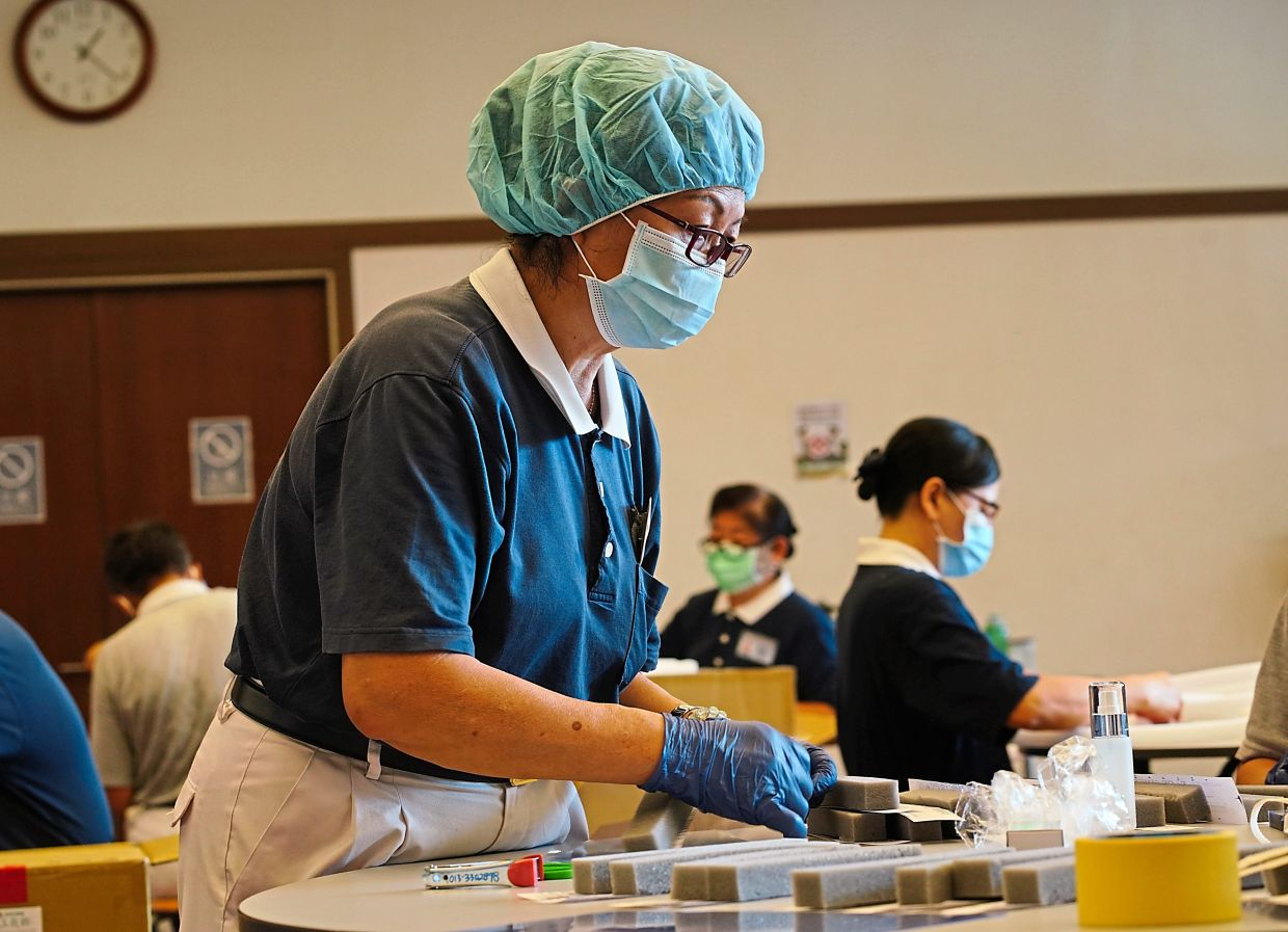 Volunteers assembling face shields for healthcare workers as part of the  foundation's Covid-19 disaster relief efforts.