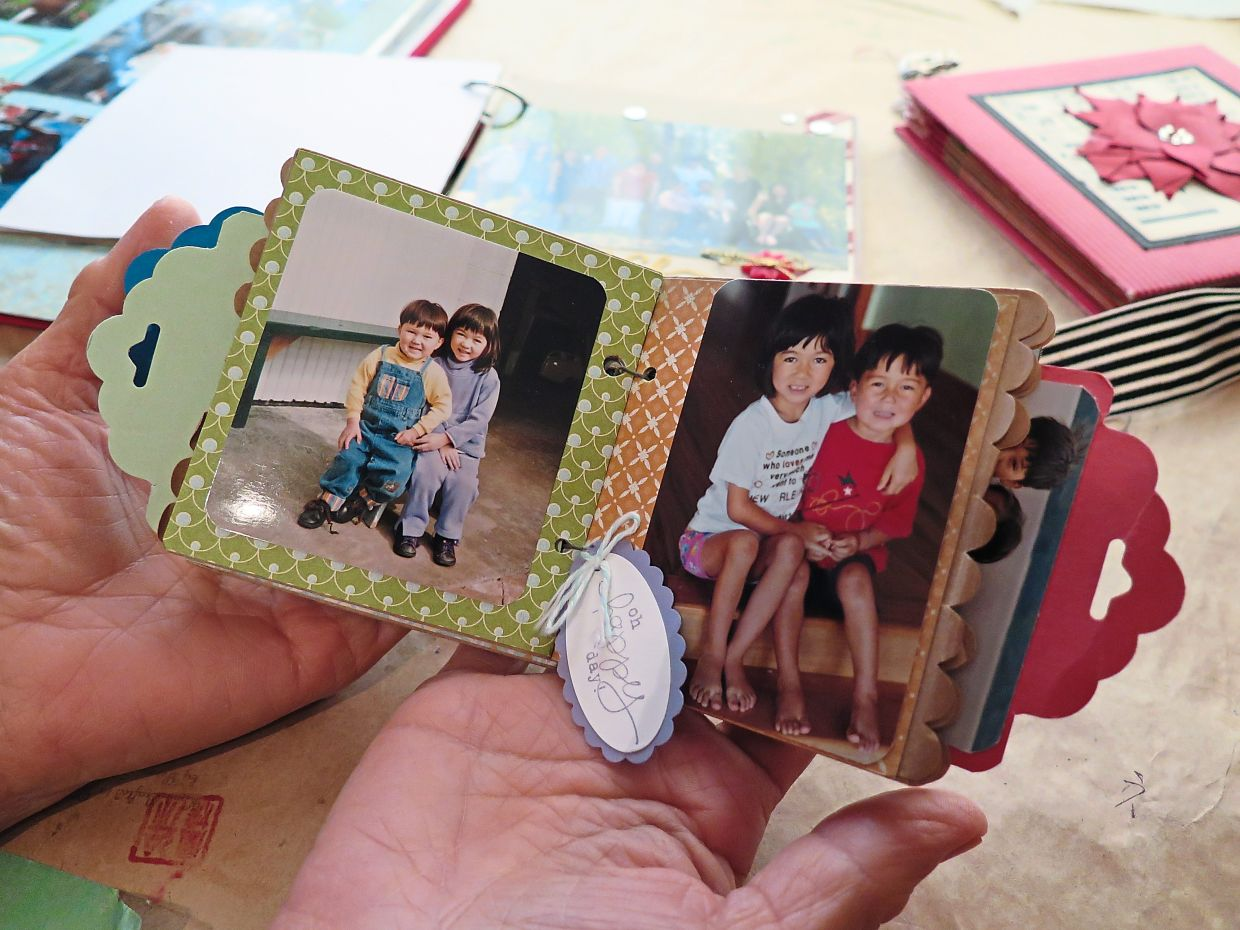 Some of the scrapbooks that Shu has made contains wonderful memories of her loved ones. — PENNY SHU