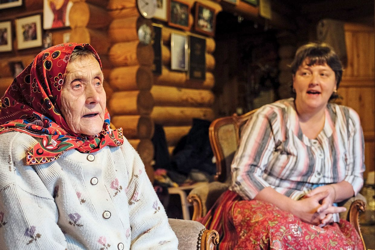 Nationally renowned folk singer Virve Koster, seen here with her granddaughter Reena, sings about island life, nature and love.