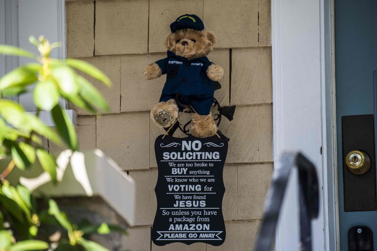 A stuffed bear near a door to give children a fun and safe activity while walking around their neighbourhood with parents in Washington, the United States. Photo: AFP