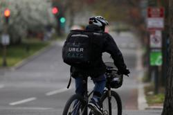 Uber connects out-of-work US ride-hail drivers to delivery, production jobs
