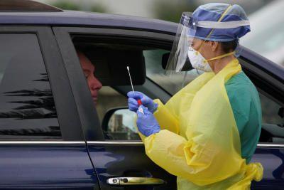 A medical personnel administers tests for the coronavirus disease (COVID-19) at the Bondi Beach drive-through testing centre in Sydney, Australia, April 7, 2020. REUTERS/Loren Elliott