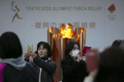 Tokyo Olympic flame taken off display, next stop unclear