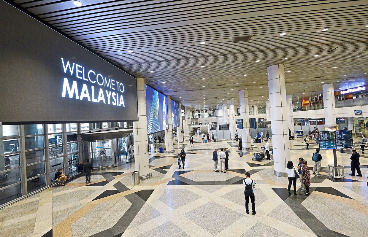 Travel hitch: Giant LCD displays at the MAHB-operated KL International Airport. The company is expected to marginally break even next year.