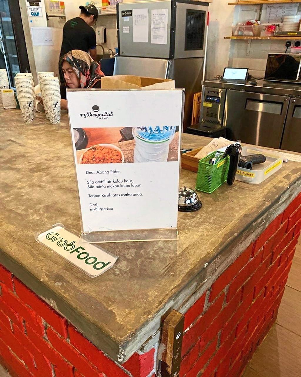 Offering delivery riders free bottled water and food is among the ways myBurgerLab gives back.