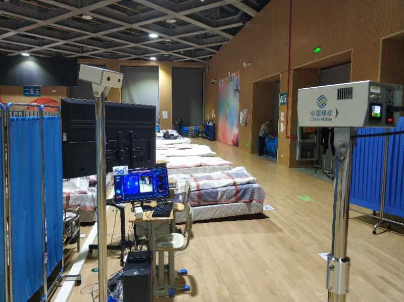 A handout picture provided by CloudMinds on April 7, 2020 and taken in early March 2020 shows an infrared temperature measurement robot at a field hospital in a sports stadium in Wuhan, in China's central Hubei province, where robots were put to use during China's coronavirus outbreak. — CloudMinds/AFP