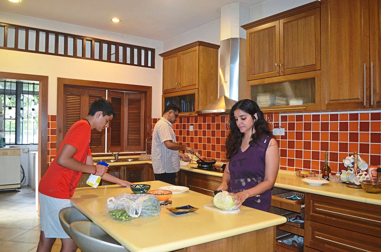 The family finds cooking together during the MCO an enjoyable activity.