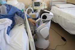 Robots hailed as heroes in war on coronavirus