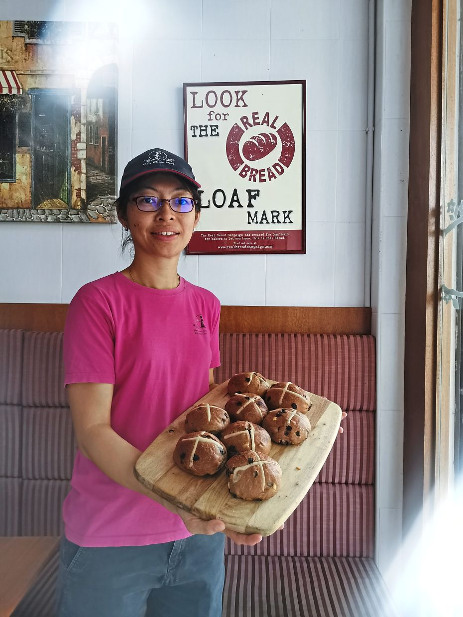 Chan with a batch of  hot cross buns at Yin's Sourdough Bakery in Penang.
