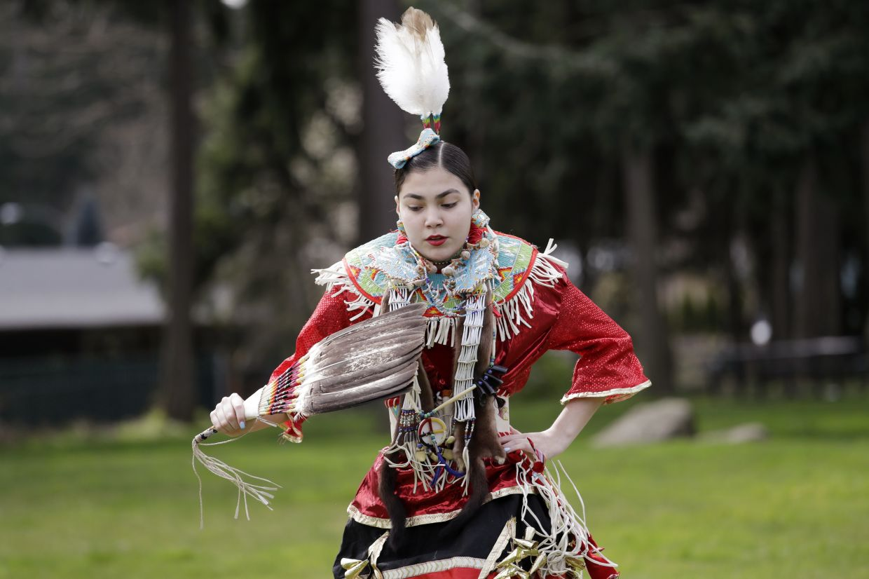 Wicahpi Cuny, 14, a Dakota and Lakota tribal member, dances during a live streamed powwow from a park near her home, in Puyallup, Washington.