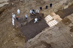 New York City hires laborers to bury dead in Hart Island potter's field amid coronavirus surge