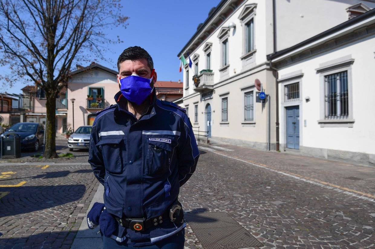 Matteo Copia, Commander of the Treviolo municipal police which uses DJI Mavic 2 Enterprise drones equipped with a thermal sensor for checking people's temperature, in Treviolo, near Bergamo, during the country's lockdown aimed at stopping the spread of the Covid-19 pandemic, caused by the novel coronavirus.
