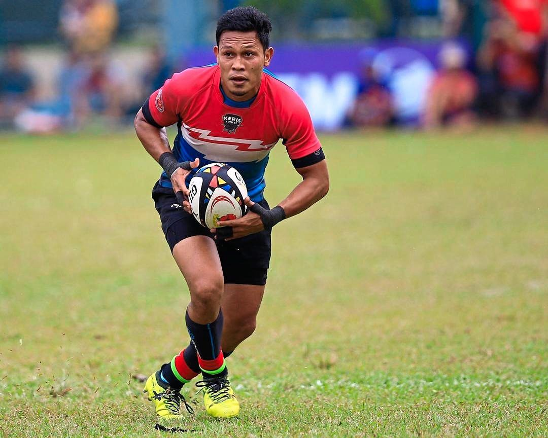 Fairuz in action on the rugby field.