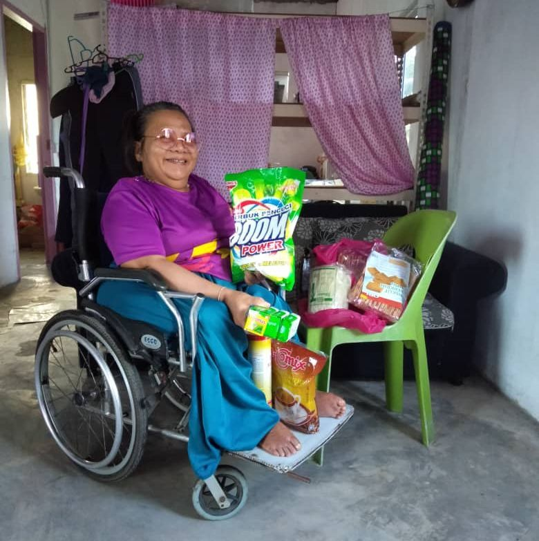 Wheelchair bound Maureen Dau happy with help of essentials from folks during this quiet Easter.