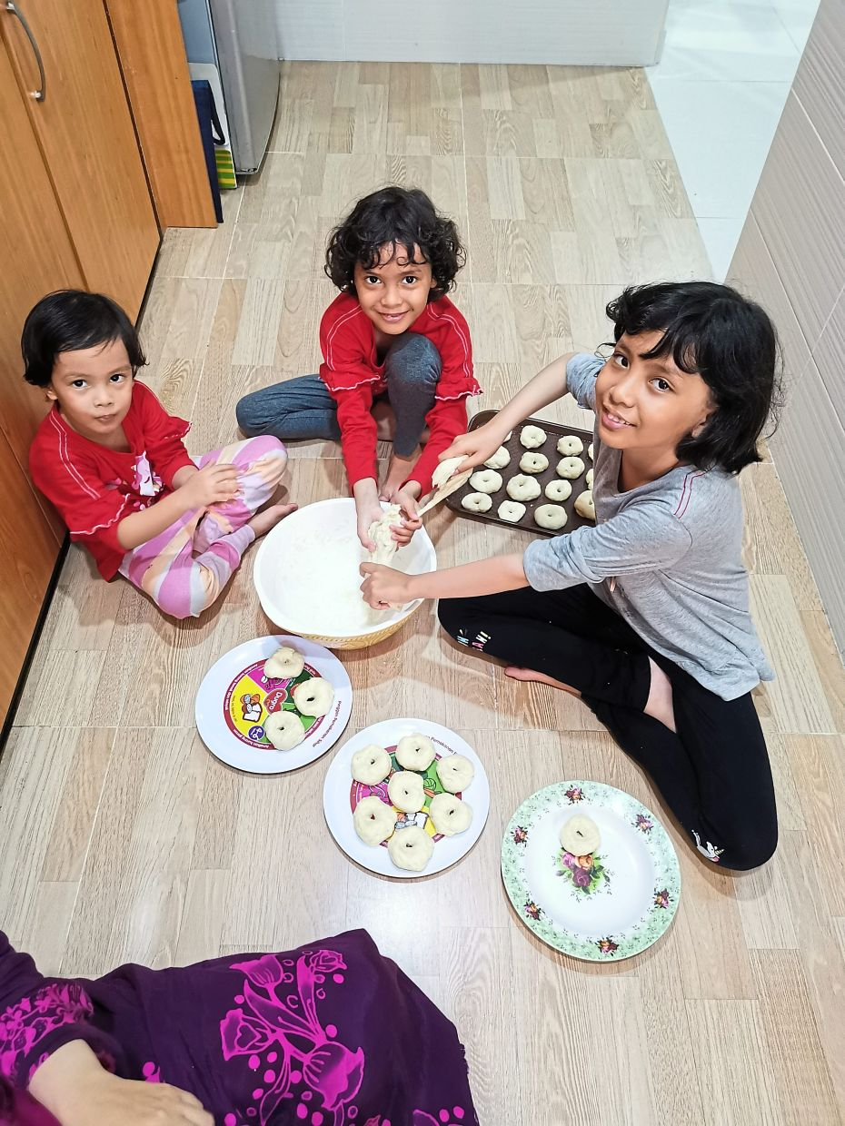 Fathiyah's three children are her kitchen helpers now. — FATHIYAH MOHAMED