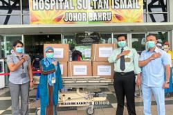 Raja Zarith Sofiah of Johor Foundation donates PPE for frontliners