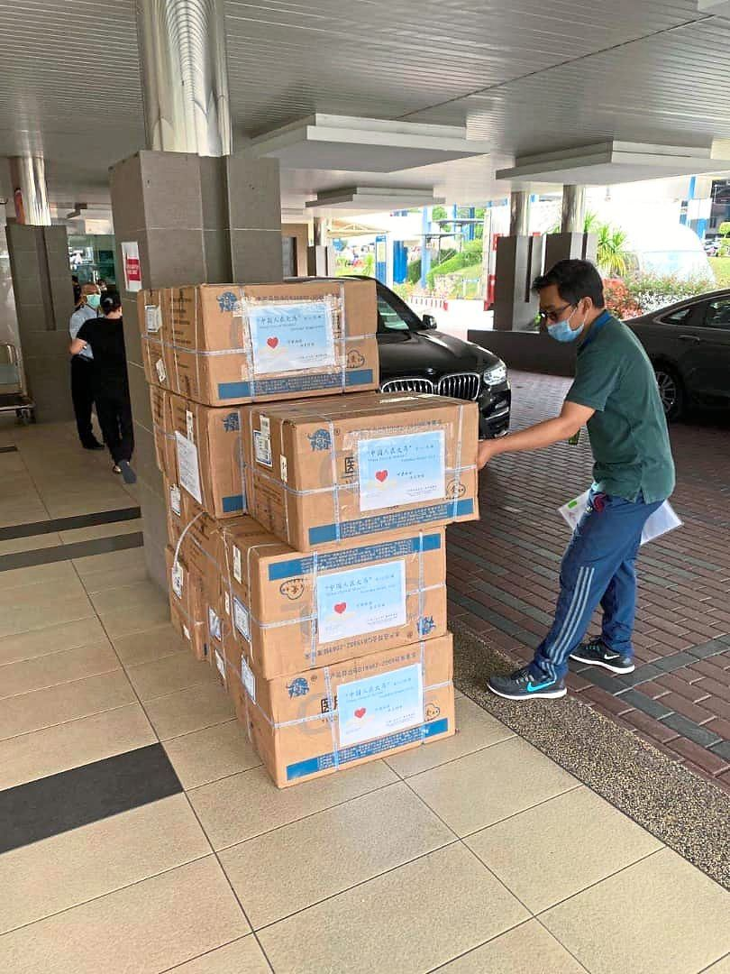 Chinese nationals living in Malaysia donating 330 sets of PPE to Hospital Kuala Lumpur. to protect Malaysian healthcare workers. Photo: Handout