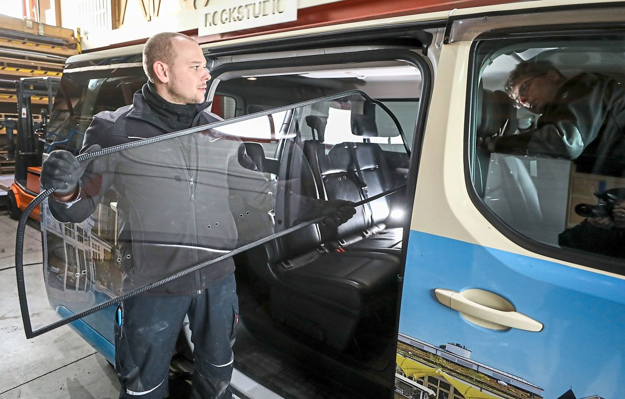 To add extra distance, taxi drivers in some countries are kitting their cars out with see-through partition walls.