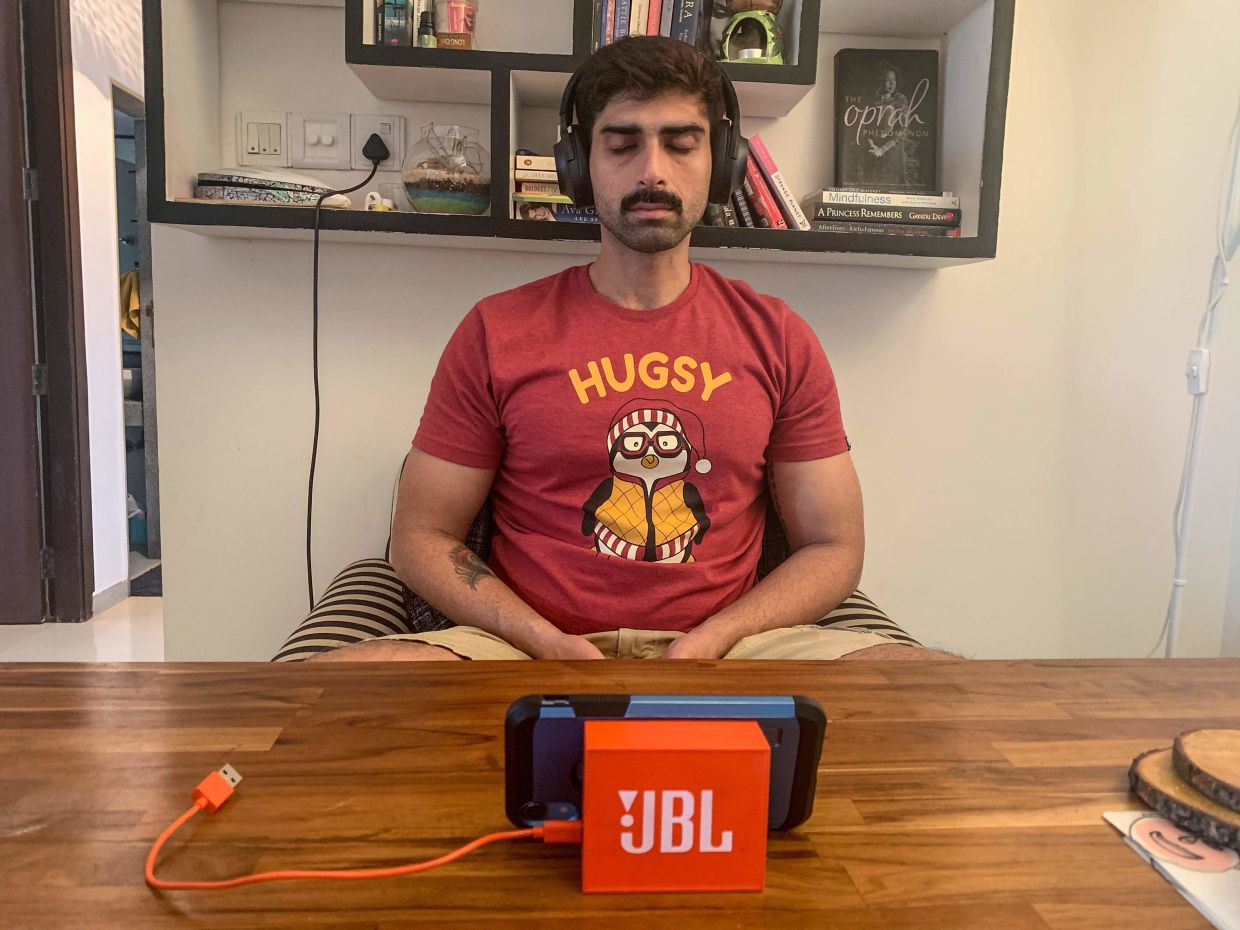 Bollywood actor and producer Akshay Dogra takes part in an online Buddhism course from a living room in Mumbai. — Tushita Meditation Centre/AFP