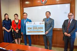Optimax group pledges RM200k to Covid-19 fight