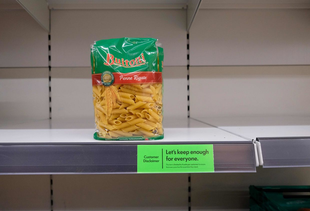 Panic buying and hoarding meant that some items like pasta were totally wiped out in supermarket shelves in many countries. — AFP