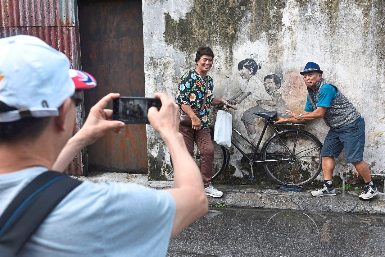 If you haven't checked out the world-famous murals at Lebuh Armenian in Penang, then put it on your travel list.  — Filepic