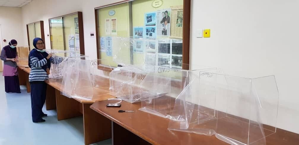 These transparent plastic head boxes help reduce the exposure of healthcare workers to a Covid-19 patient's infected droplets when they perform any respiratory procedures. — Photos: DR HARDIP SINGH GENDEH