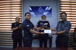 Cop who rescued puppy from drain receives commendation letter from Tengku Permaisuri of Selangor