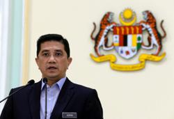 Malaysia may extend travel curbs, but with more sectors open, says Azmin