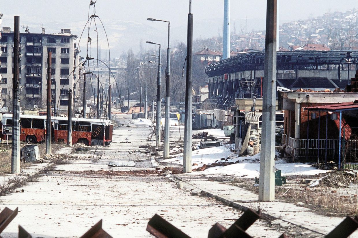 Buildings and vehicles destroyed in Grbavica, a suburb of Sarajevo, Bosnia and Herzegovina, during the Bosnian conflict (1992–95). — Lt. Stacey Wyzkowski/US Department of Defense.