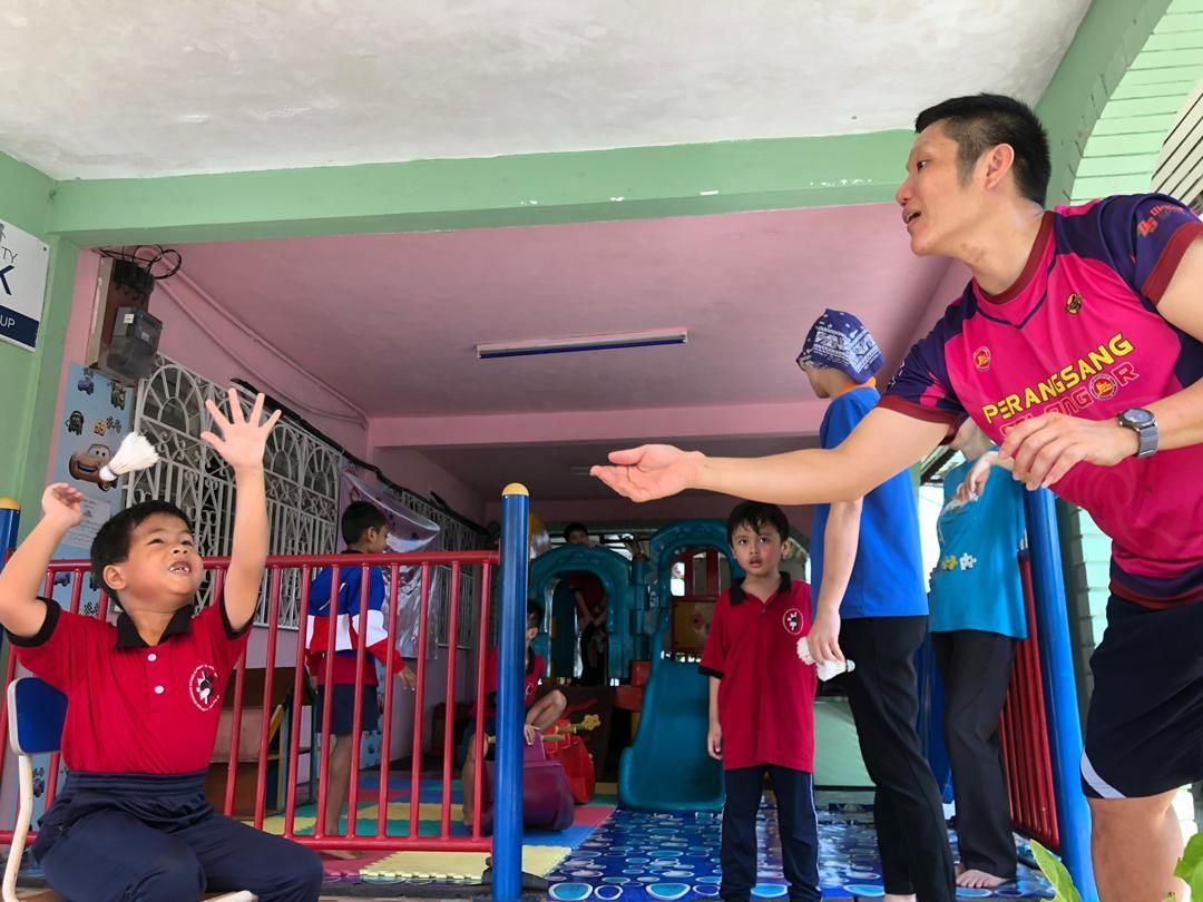 Former national shuttler Jason Wong (right) doesn't mind going the extra mile to help children with special needs. Photo: Jason Wong