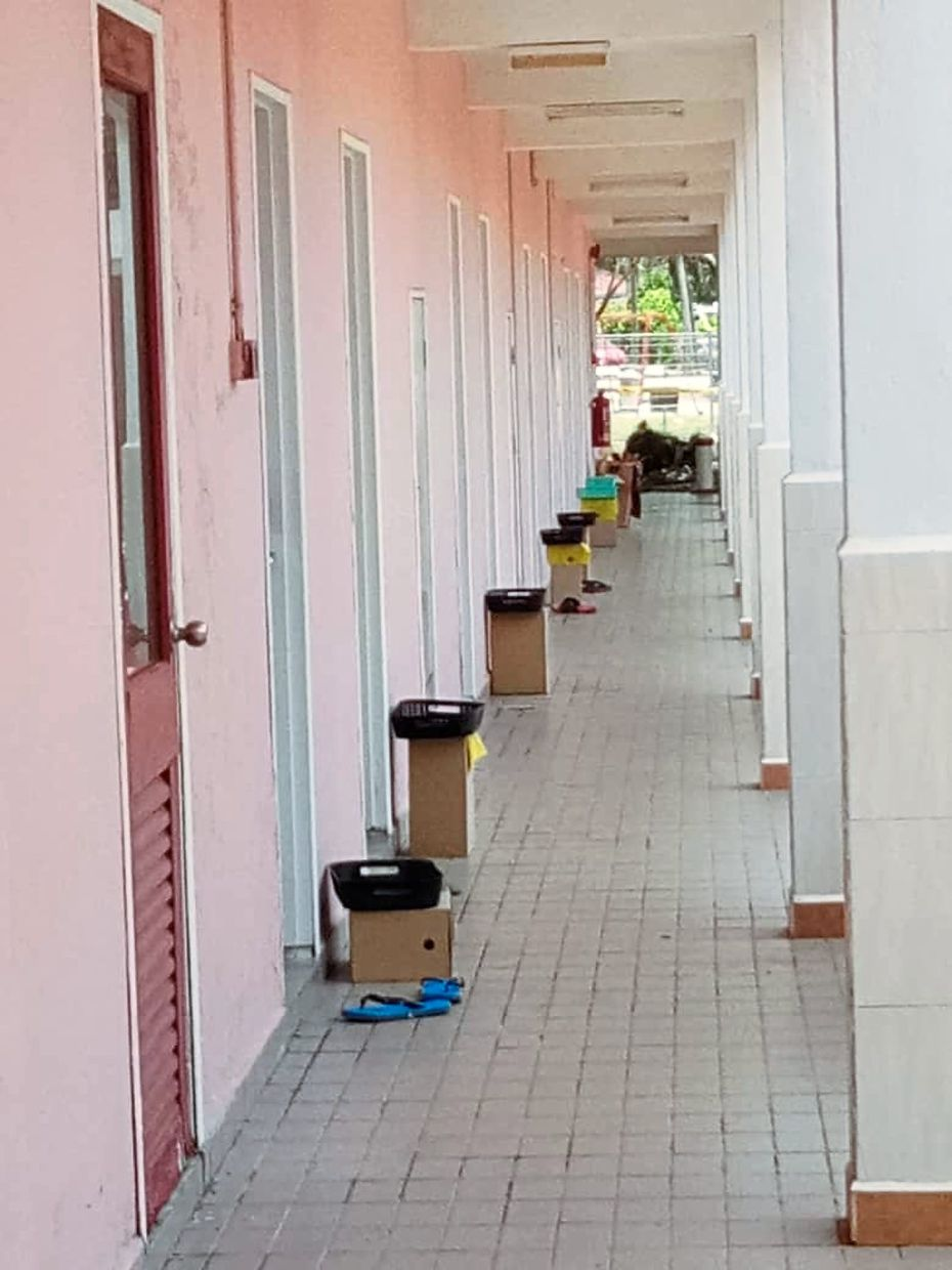 Meals are placed on the boxes outside guests' rooms at a budget hotel in Mersing.