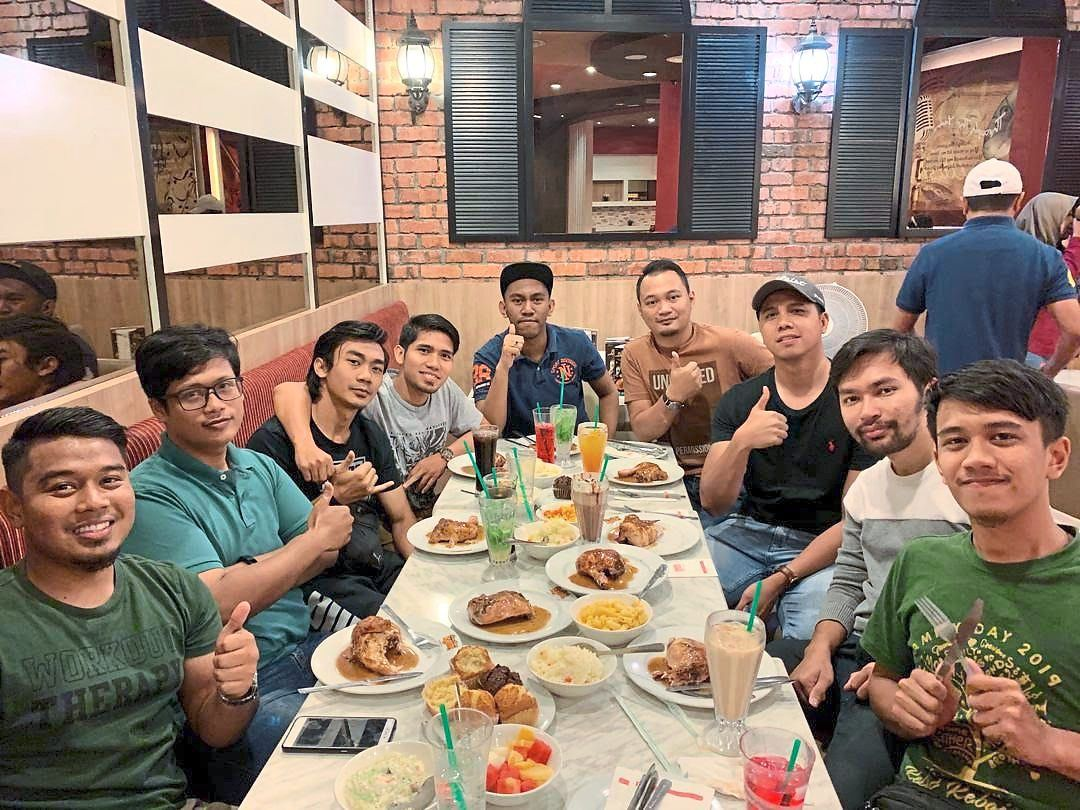 Unable to buy food from Ramadan bazaars this year, Arif (fourth from right) and his housemates have planned what they will cook all month.