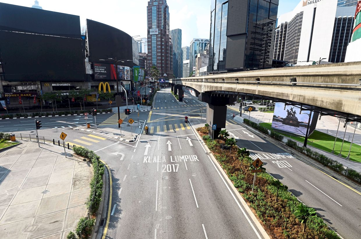 The Bukit Bintang area in KL, which is popular with tourists, is nearly deserted during the MCO. — AZHAR MAHFOF/The Star