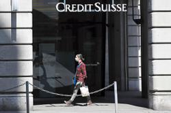 Credit Suisse takes US$1bil writedowns