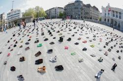 Shoes replace protesters as Swiss climate activists obey virus curbs