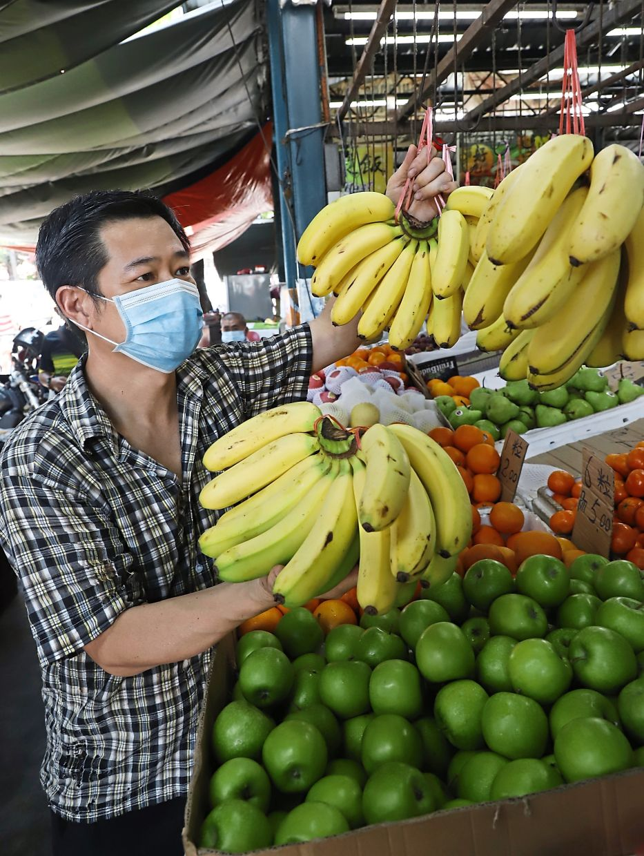 Chin says his customers buy a lot of bananas and oranges but sales of mangoes have dropped.