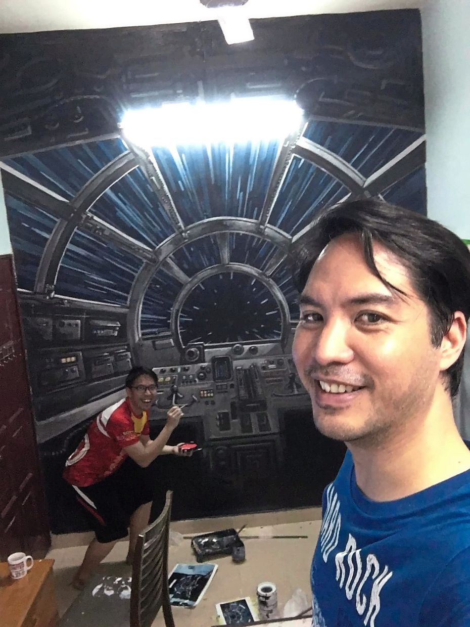 Jon working on the mural before the MCO came into effect as Ridzuan takes a wefie.
