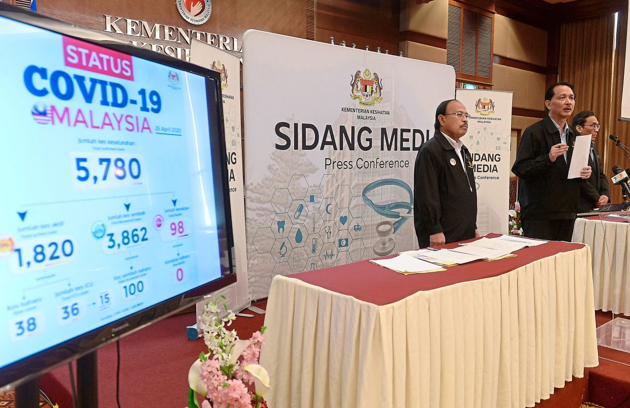 Encouraging statistics: Dr Noor Hisham speaking during the daily Covid-19 press briefing at the Health Ministry headquarters in Putrajaya. Looking on is his deputy Datuk Dr Rohaizat Yon (left). — Bernama